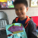 Liholiho Elementary 2nd grader learning about ocean pollution and incorporating marine debris into his fish drawing.